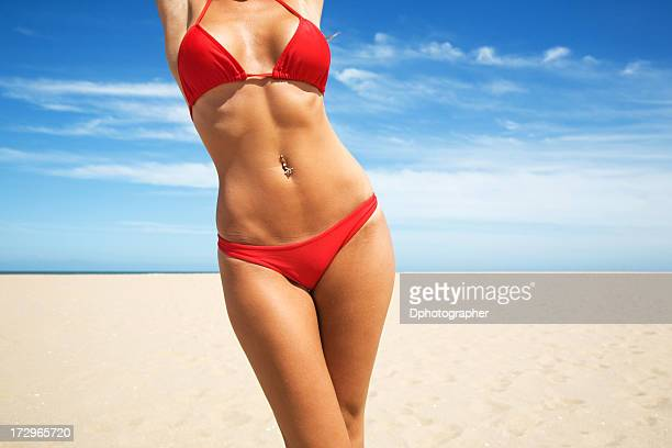Woman wearing red bikini with beach background