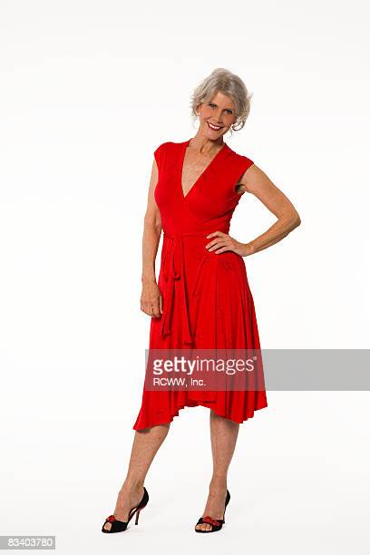 woman wearing red dress - red dress stock pictures, royalty-free photos & images
