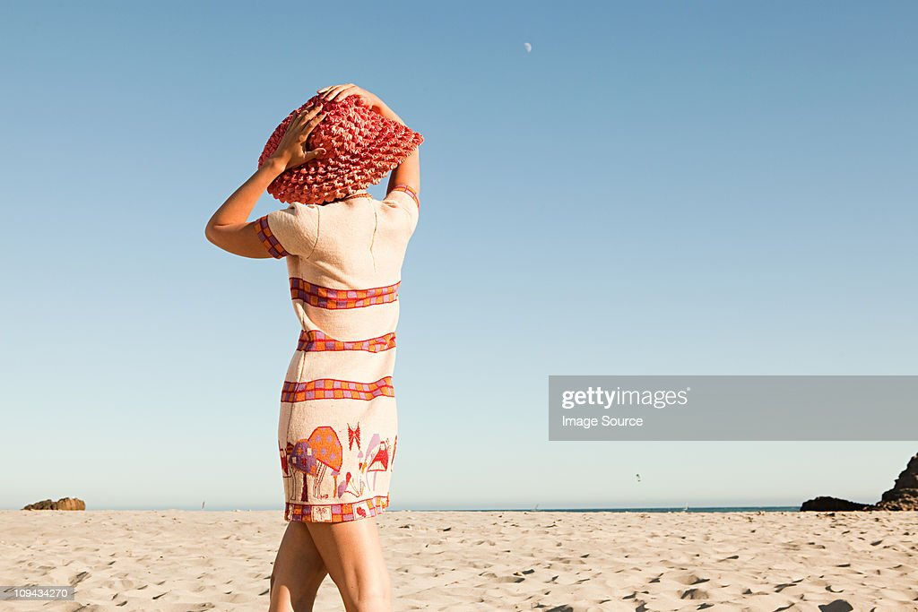 Woman wearing red hat on vacation : Stock Photo