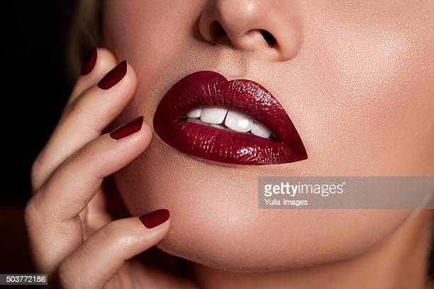 Woman Wearing Red Lipstick and Nail Polish