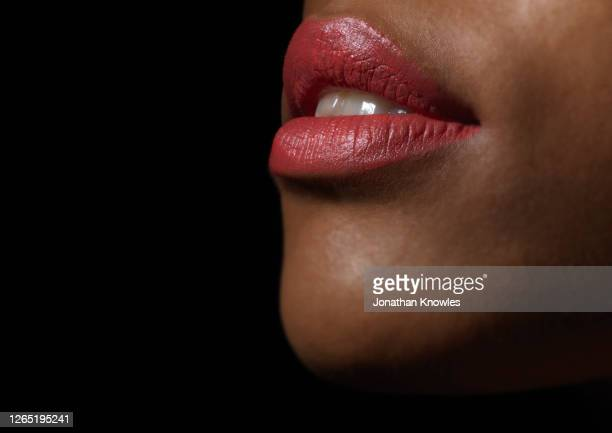 woman wearing red lipstick - matte lips stock pictures, royalty-free photos & images