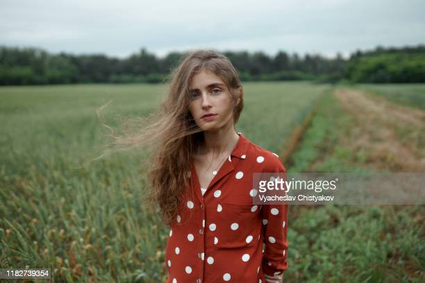 woman wearing red polka dot shirt in wheat field - polka dot stock pictures, royalty-free photos & images