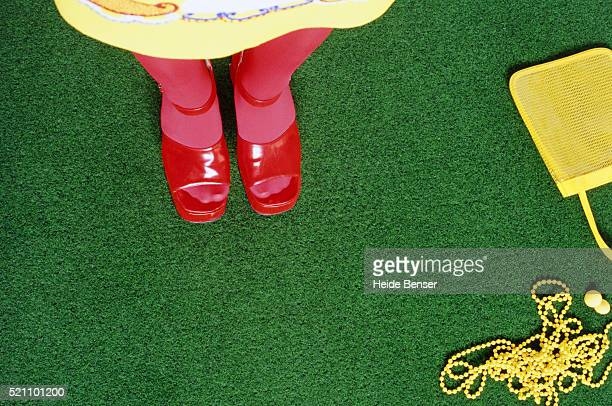 Woman wearing red socks and shoes