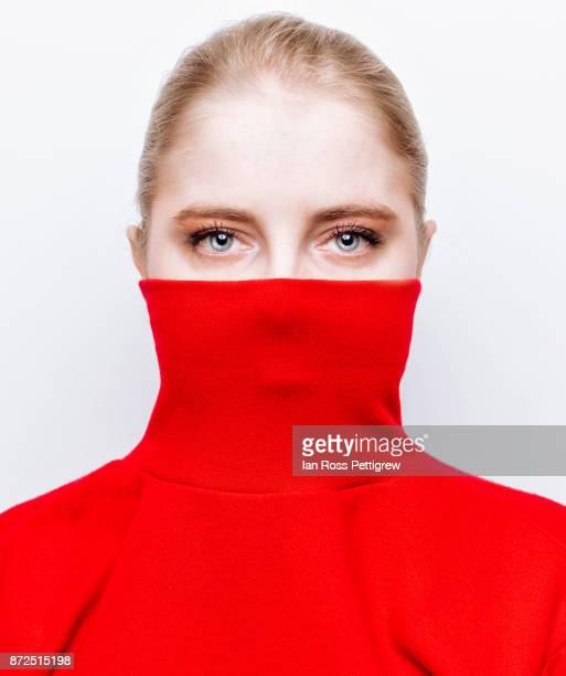 woman wearing red sweater - coltrui stockfoto's en -beelden