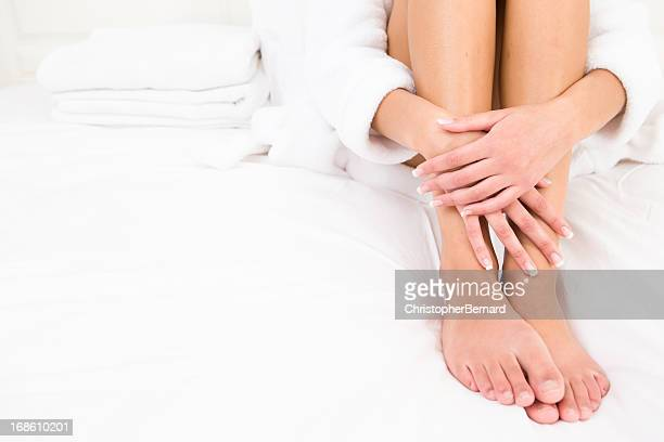woman wearing robe sitting on bed - beautiful female feet stock photos and pictures