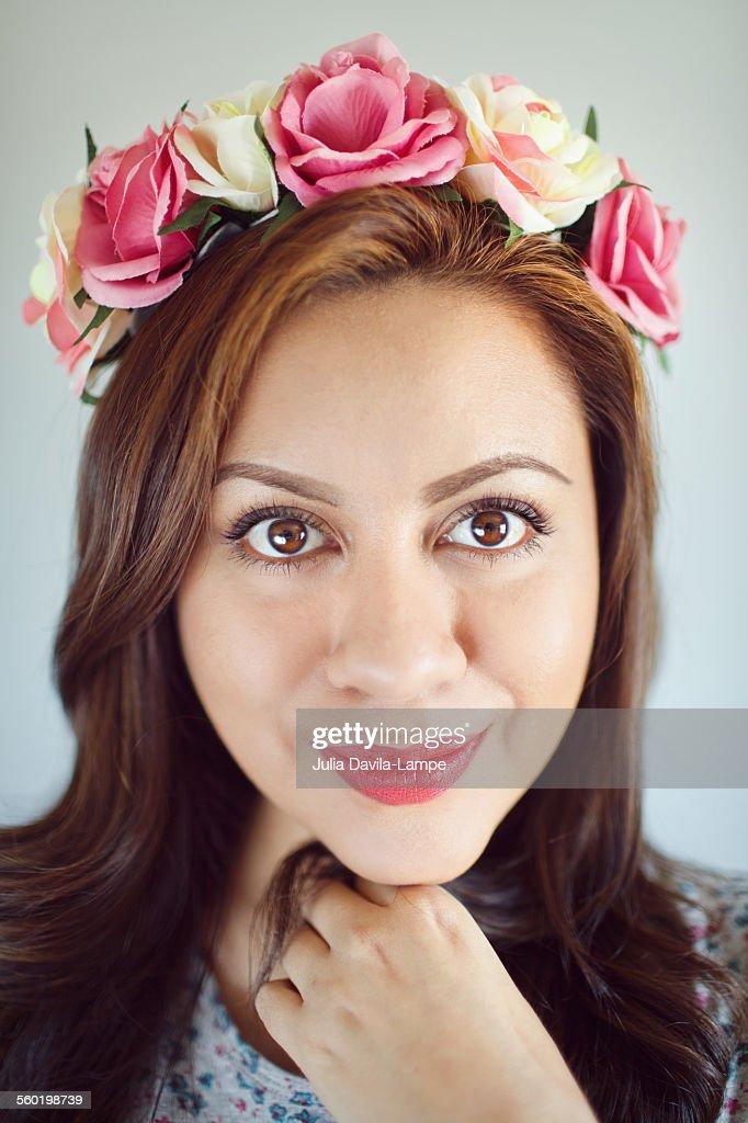 Woman wearing roses wreath. : Stock Photo