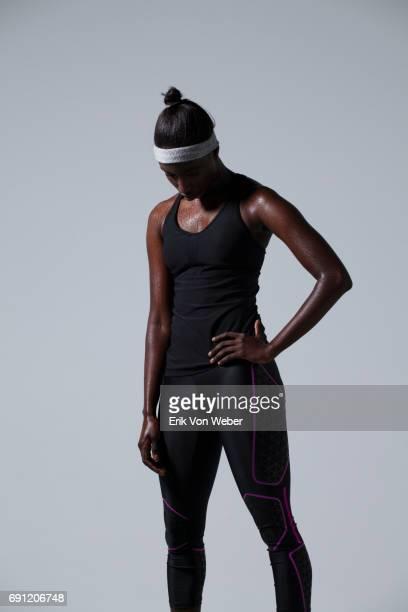Woman wearing running apparel in studio
