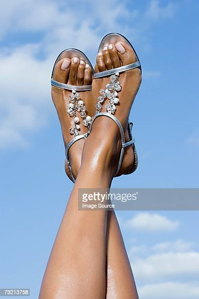woman wearing sandals - open toe stock pictures, royalty-free photos & images