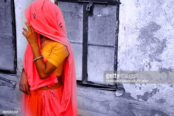 Woman Wearing Sari Standing Outside House