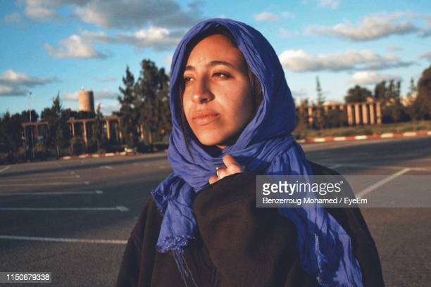 woman wearing scarf while looking away in city - algiers algeria stock pictures, royalty-free photos & images