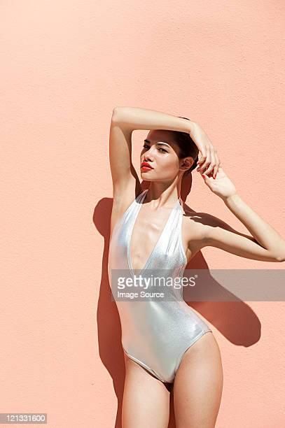 Woman wearing sexy silver  bikini