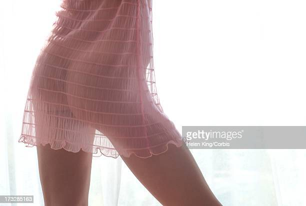 woman wearing sheer nightgown - see thru nightgown stock photos and pictures