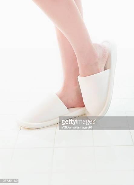 Woman wearing slippers