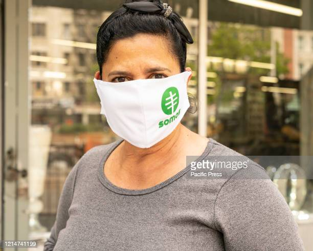 A woman wearing special face mask waits for antibody swab tests for COVID19 at SOMOS Community Care site in Washington Heights Latino community SOMOS...