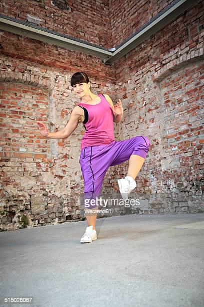 Woman wearing sport dress dancing zumba or aerobics in gym