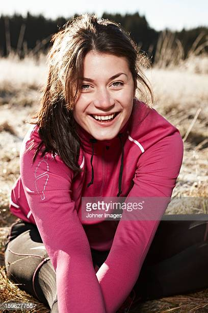 Woman wearing sportswear smiling to camera