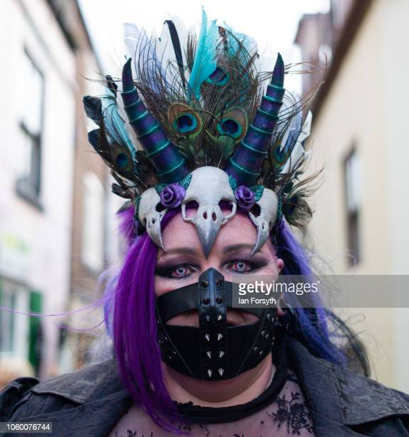 A woman wearing steam punk clothing poses for photographs during Whitby Goth Weekend on October 27 2018 in Whitby England The Whitby Goth weekend...