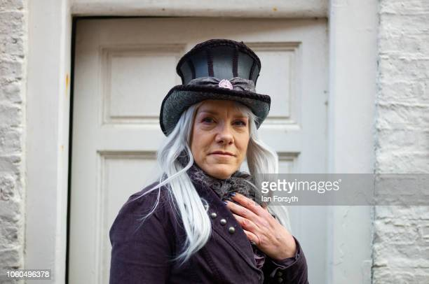 A woman wearing steam punk clothing poses for photographs in a doorway during Whitby Goth Weekend on October 28 2018 in Whitby England Whitby Goth...