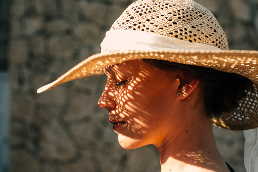 Woman wearing straw hat - gettyimageskorea