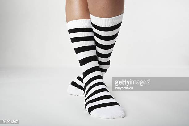 woman wearing striped socks. - legs crossed at ankle stock pictures, royalty-free photos & images