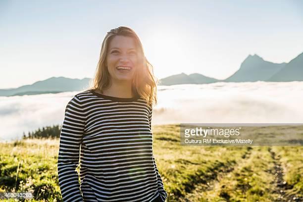 Woman wearing striped top, Tyrol, Austria