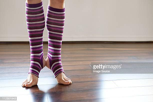 woman wearing stripey legwarmers on tiptoe - レッグウォーマー ストックフォトと画像