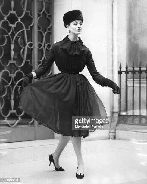 A woman wearing suit ushanka and gloves by the French stylist Christian Dior 1956