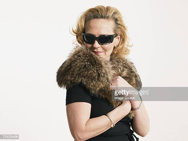 Woman wearing sunglasses and fur