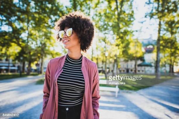 Woman wearing sunglasses in the city