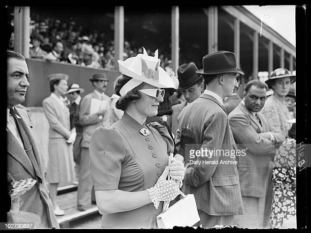 Woman wearing sunglasses Royal Richmond Horse Show June 1939 Woman in sunglasses hat and gloves standing with other spectators at the Royal Richmond...