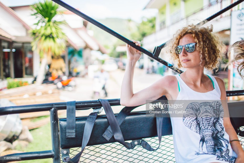 Woman Wearing Sunglasses While Sitting On Ride : Stock Photo