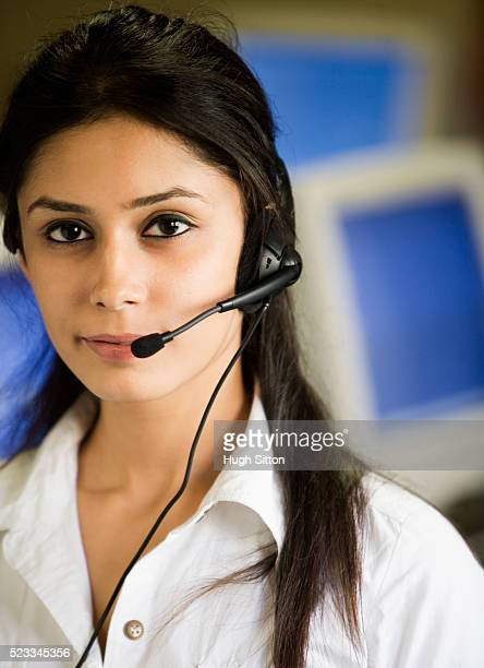 woman wearing telephone headset - hugh sitton bildbanksfoton och bilder
