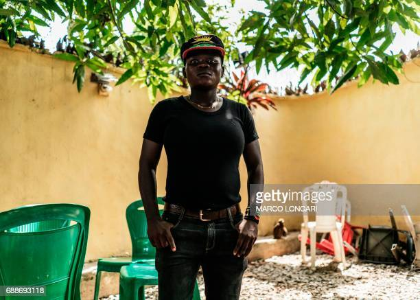 A woman wearing the insignia of the Indigenous People of Biafra movement poses during a meeting between veterans of the Nigerian civil war and...