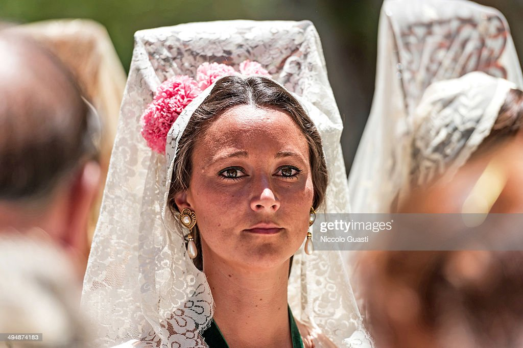 A woman wearing the traditional Mantilla during the 50th Anniversary of 'La Macarena' crowning in the 'Plaza de Espana' Square on May 31, 2014 in Seville, Spain. Seville locals and visitors from around the world come in the masses to observe the grande celebration of the Jubilee Year of La Macarena held to mark the 50th anniversary of the canonical coronation of the Virgin of La Macarena, a 17th century Roman Catholic wooden image of the Blessed Virgin Mary venerated in Seville and one of the city's most popular symbols.