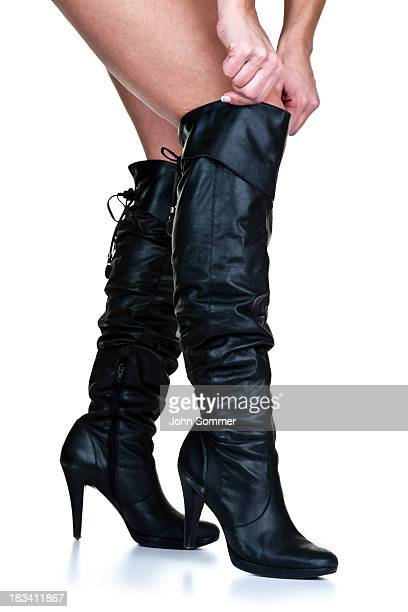 woman wearing thigh high boots - black boot stock pictures, royalty-free photos & images
