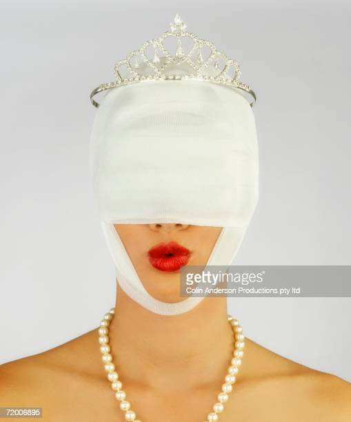 woman wearing tiara and plastic surgery bandages - crown stock pictures, royalty-free photos & images