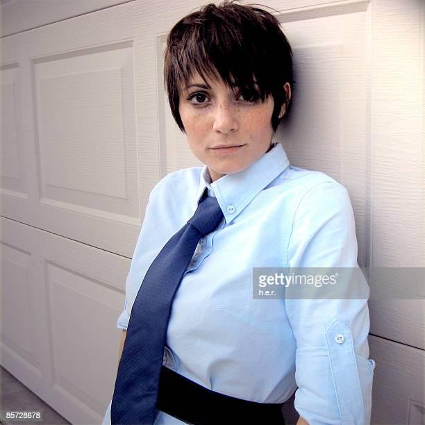 Woman wearing tie smiling, portrait