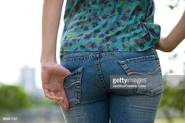 Woman wearing tight jeans, close-up of buttocks
