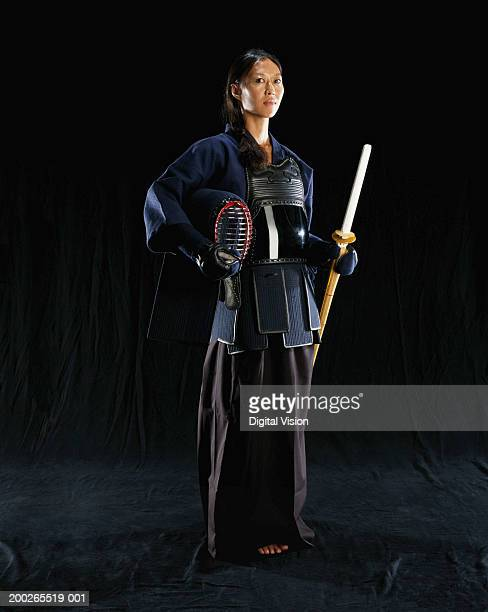 Woman wearing traditional Aikido costume, looking away
