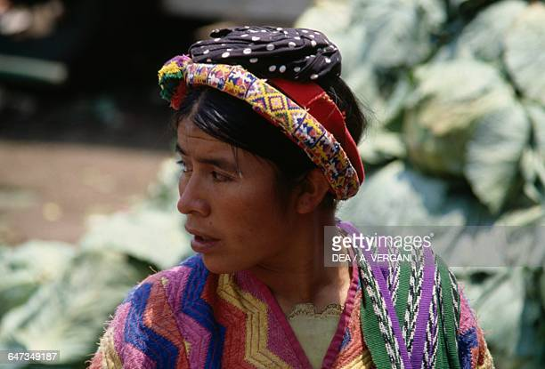 Woman wearing traditional clothes at the Quetzaltenango market Sierra Madre Guatemala
