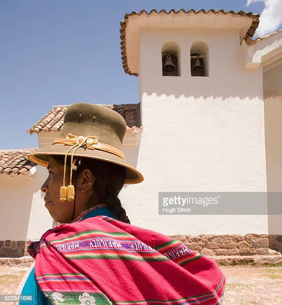 woman wearing traditional clothing standing near church - hugh sitton stock pictures, royalty-free photos & images