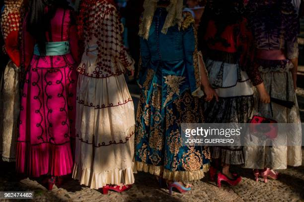 TOPSHOT Woman wearing traditional costumes take part in the reenactment of a battle of the Spanish War of Independence against France in Ronda...