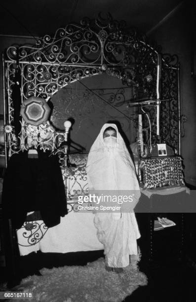 A woman wearing traditional dress in a house in the Casbah of Algiers