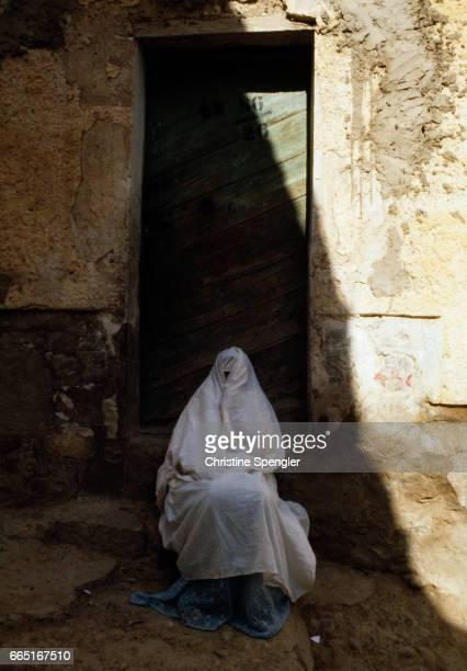 A woman wearing traditional dress in the Casbah of Algiers