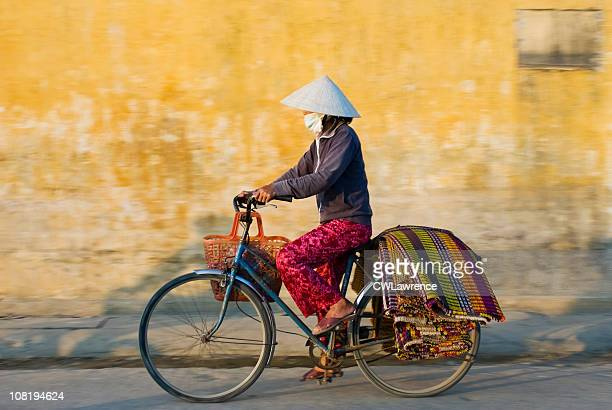 Woman Wearing Traditional Dress in Vietnam Riding Bicycle