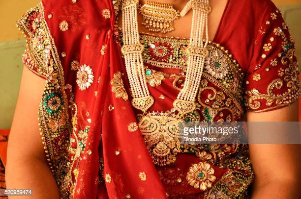 Woman wearing traditional gold jewellery in neck, Rajasthan, India, Asia