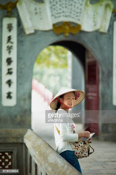 Woman wearing traditional straw hat