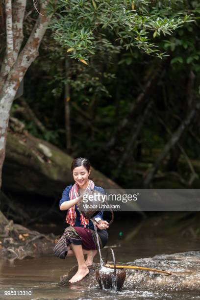 Woman wearing traditional Thai rural in the forest