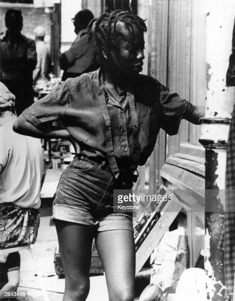 A woman wearing turnedup denim hot pants in Portobello Market London