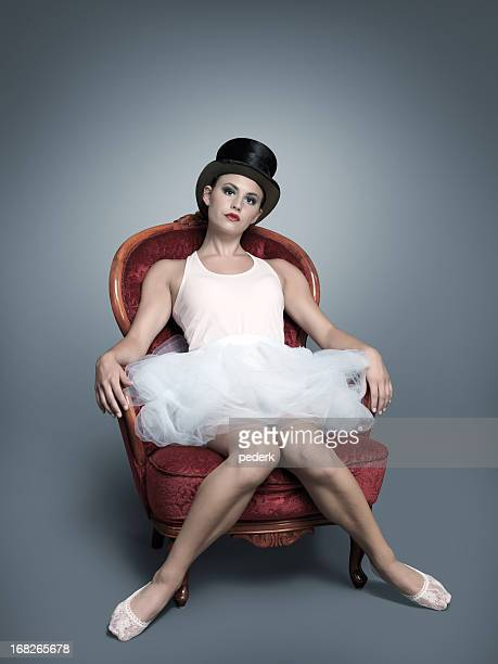 Woman wearing tutu sitting on red chair